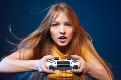 Girl playing video game with joystick. Computer game competition. Gaming concept. Excited girl playing video game with joystick stock images