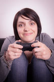 Girl playing video games. On the couch Stock Photo