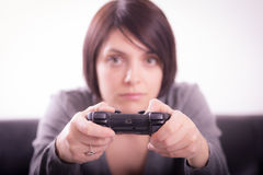 Girl playing video games Royalty Free Stock Images
