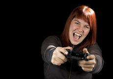 Girl Playing Videogames. Girl using the sixaxis game controller and playing video games on her Playstation Stock Image
