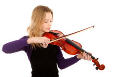 Girl is playing the violin Royalty Free Stock Photography