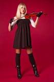 Girl playing violin Stock Image