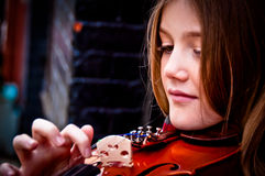 Girl playing violin Stock Photos