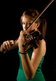 Girl playing violin Stock Photography