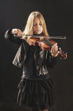 Girl Playing the Violin Royalty Free Stock Photography