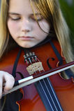 Girl playing the violin Stock Image