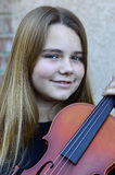 Girl playing the violin Royalty Free Stock Photo