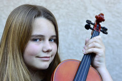 Girl playing the violin Stock Images