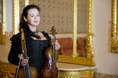 Girl playing violin Stock Photography
