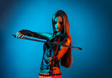 Girl playing the violin Stock Photos