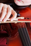 Girl playing violin - bow in arm and strings Royalty Free Stock Photos