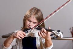 Girl playing violin Royalty Free Stock Image