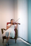 Girl playing violin at home studio Royalty Free Stock Images