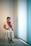 Girl playing violin at home studio Royalty Free Stock Photo