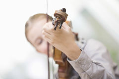 Girl Playing Violin At Home Royalty Free Stock Photos