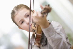 Girl Playing Violin At Home Stock Images