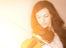 Girl playing the violin. Royalty Free Stock Photo