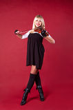 Girl playing violin in studio smile Royalty Free Stock Photography