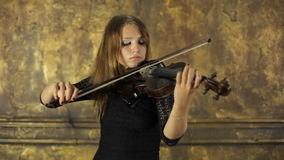 Girl playing violin on vintage background stock video