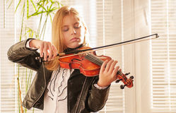 Girl Playing  Violin Stock Images