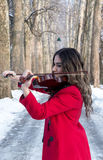 Girl playing violine royalty free stock photos