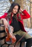 Girl playing violine stock photography
