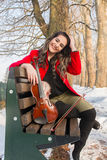 Girl playing violine. Beautiful young girl playing violin royalty free stock images