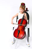 Girl playing on violoncello. Girl playing her violoncello on white background stock image