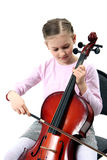 Girl playing on violoncello. Girl playing her violoncello on white background royalty free stock images