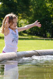 Girl playing with water Stock Image