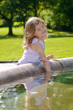 Girl playing with water Royalty Free Stock Images