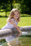 Girl playing with water stock photography