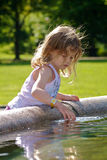 Girl playing with water Royalty Free Stock Image