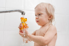 Girl playing with water in the bath Royalty Free Stock Photography