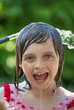 Girl playing with water Royalty Free Stock Photos