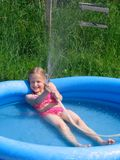 Girl playing with the watter Royalty Free Stock Photo