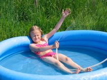 Girl playing in the watter Stock Images