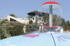 Girl playing on wet bubble game pool Stock Photos