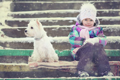 Girl playing with a white dog winter snow Royalty Free Stock Image