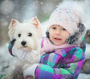 Girl playing with a white dog winter snow Stock Photos