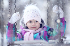 Girl playing with a white dog winter snow Stock Images
