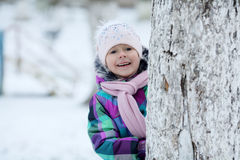 Girl playing with a white winter snow Stock Images