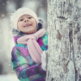 Girl playing with a white winter snow Royalty Free Stock Photos