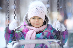 Girl playing with a white winter snow Royalty Free Stock Images