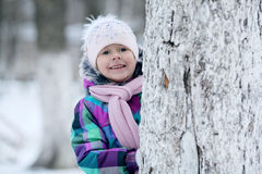 Girl playing with a white winter snow Stock Photography
