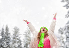 Girl playing on a winter walk Stock Photos