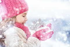 Girl playing on a winter walk Stock Photography