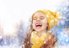 Girl playing on a winter walk Stock Image