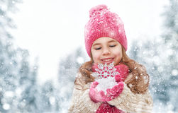 Girl playing on a winter walk Royalty Free Stock Photos