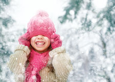 Girl playing on a winter walk Royalty Free Stock Photography